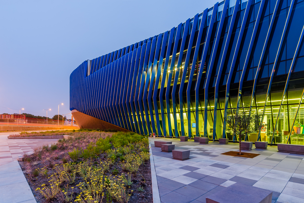 A photo of the NEIU building at dusk.